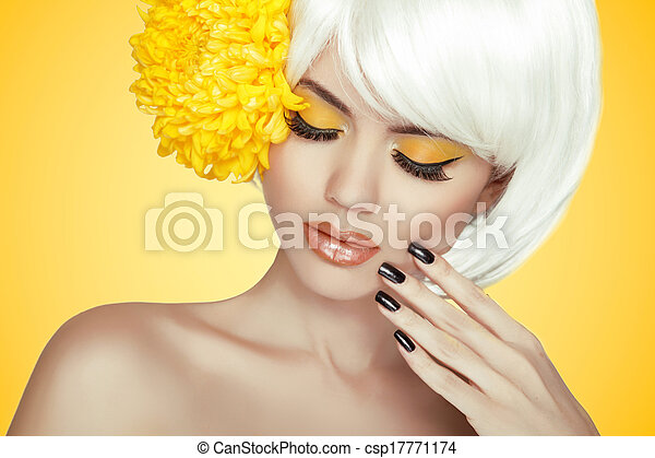 Beauty Portrait. Makeup. Manicured nails. Beautiful Spa Woman Touching her Face. Perfect Fresh Skin. Pure Beauty Model Girl. Isolated on yellow background - csp17771174