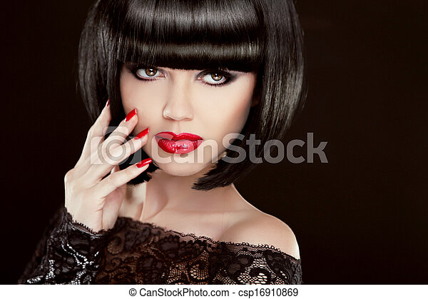 Beauty Portrait. Sexy brunette woman with short hair, red lips, manicured nails. Makeup. Hairstyle. Isolated on black background - csp16910869