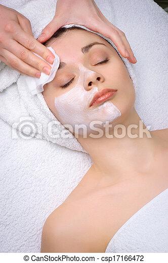 beauty salon series. facial mask removing - csp17166472