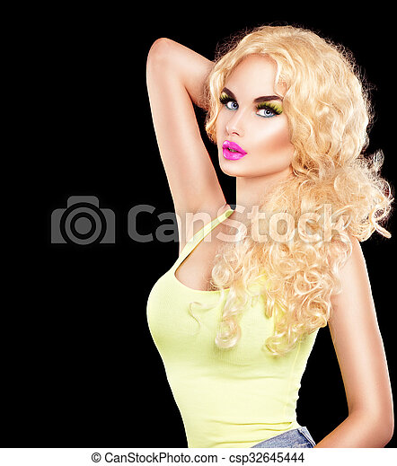 Beauty sexy model girl touching her long curly hair - csp32645444
