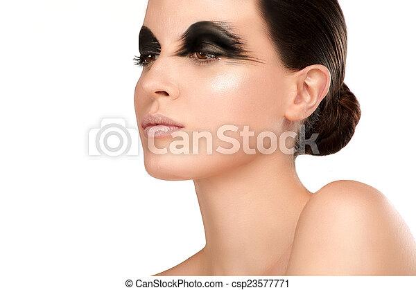 Beauty shot artistic smoky eye on beautiful model - csp23577771