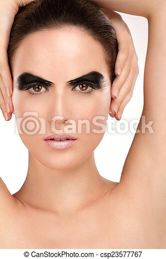 Beauty shot artistic smoky eye on beautiful model - csp23577767