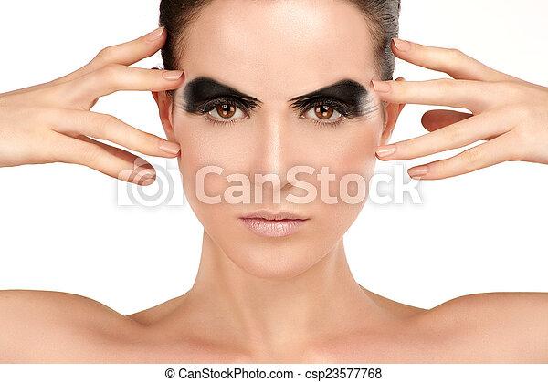 Beauty shot artistic smoky eye on beautiful model - csp23577768