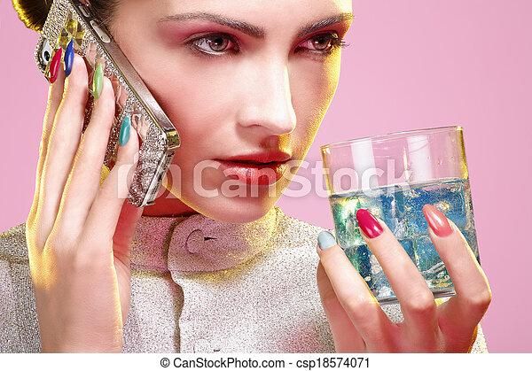 Beauty shot of model wearing colorful nail polish - csp18574071