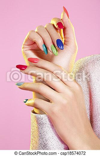 Beauty shot of model wearing colorful nail polish - csp18574072