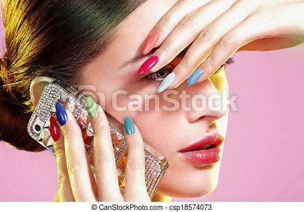 Beauty shot of model wearing colorful nail polish - csp18574073