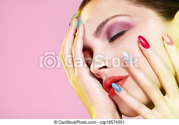 Beauty shot of model wearing colorful nail polish - csp18574301
