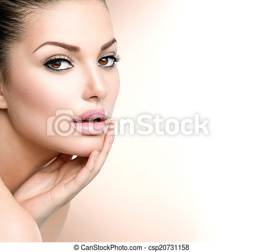 Beauty Spa Woman Portrait. Beautiful Girl Touching her Face - csp20731158