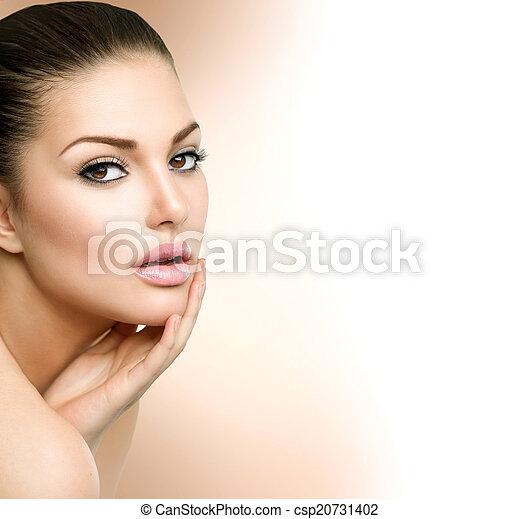 Beauty Spa Woman Portrait. Beautiful Girl Touching her Face - csp20731402