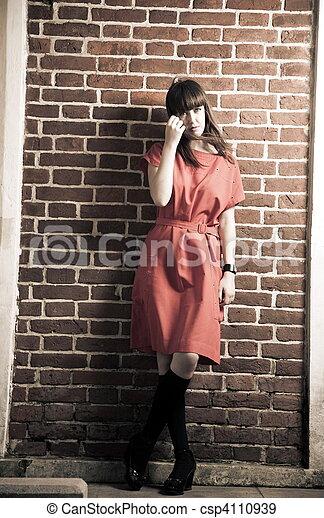 Beauty Woman Against Brick Wall - csp4110939