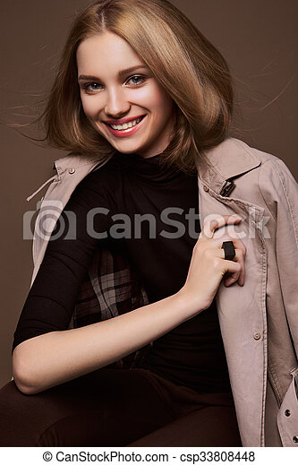 Beauty Woman. Beautiful Young Female. Portrait isolated on Brown Background. Healthcare. Perfect Skin.  - csp33808448