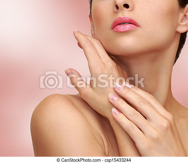 Beauty woman hands with health skin on pink background - csp15433244
