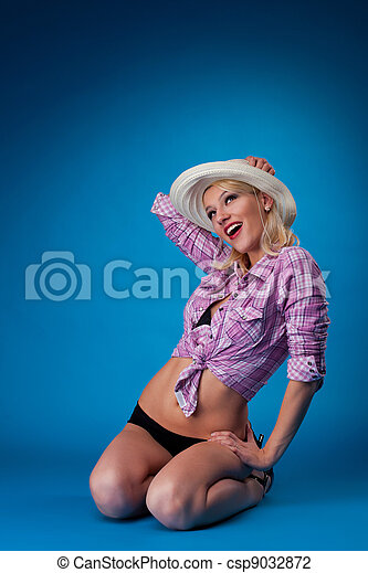 Beauty woman in farm cloth and straw hat - csp9032872