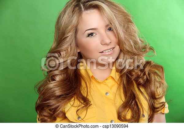 Beauty woman portrait of teen girl beautiful cheerful enjoying with long brown hair and clean skin over green background - csp13090594
