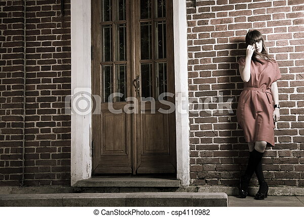 Beauty Woman Standing Against Brick Building - csp4110982