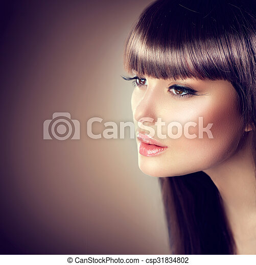 Beauty woman with beautiful make up and healthy smooth brown hair - csp31834802