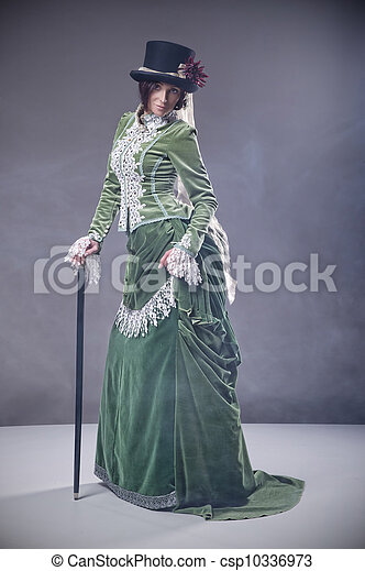 Beauty woman with walking stick wearing old fashioned dress - csp10336973