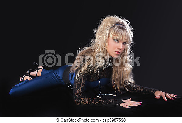 beauty young blond girl lay on ground - csp5987538