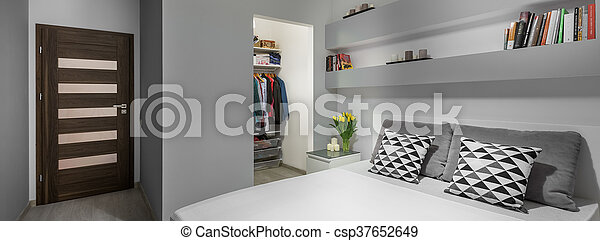 Bed and wardrobe in bedroom - csp37652649