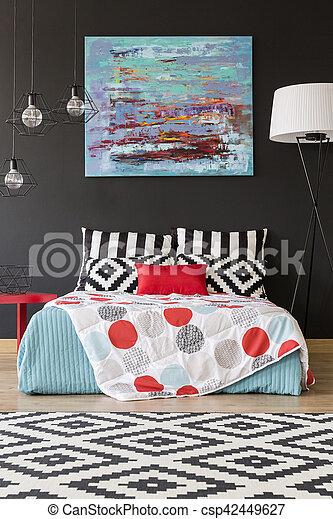 Bed in a black bedroom - csp42449627