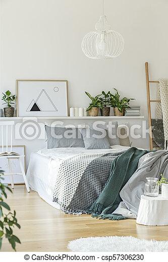 Bed in bright bedroom interior - csp57306230