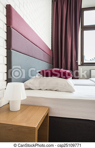 Bed with colourful headboard - csp25109771