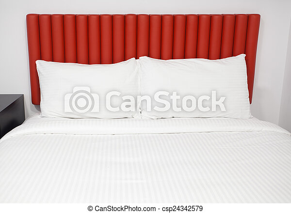 Bed with headboard and pillows - csp24342579