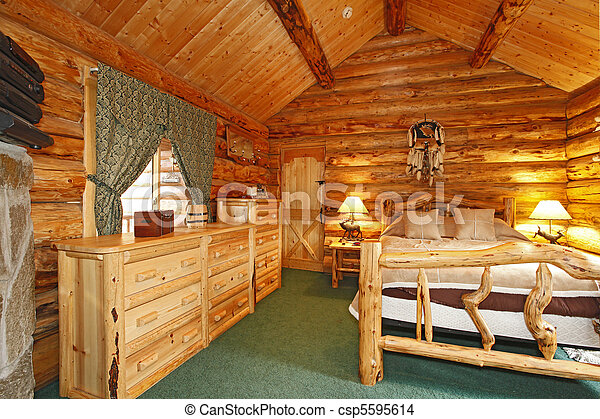 Bedroom in a rustic cabin - csp5595614