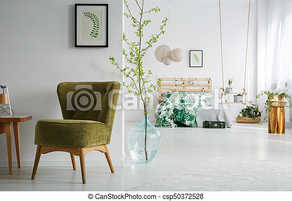 Bedroom with green wintage chair