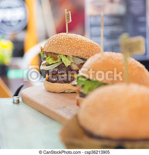 Beef burgers being served on street food stall - csp36213905