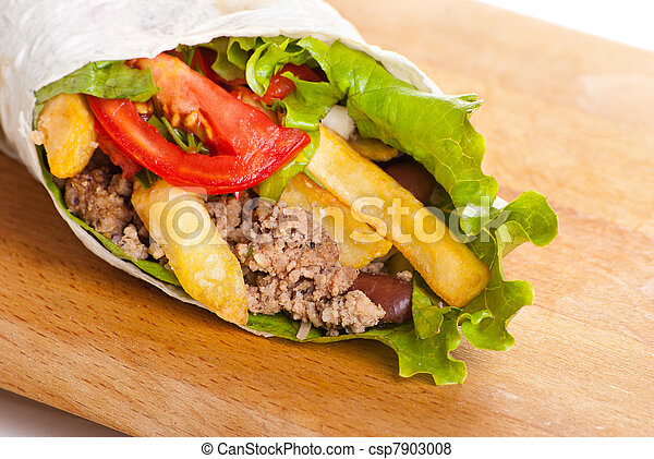 beef burrito with peppers, fried potato and tomato - csp7903008