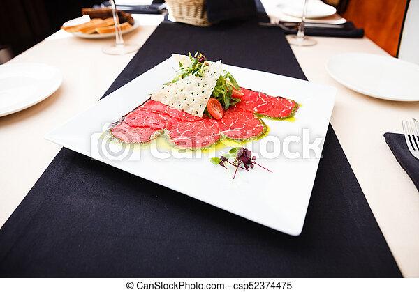 Beef carpaccio with salad - csp52374475