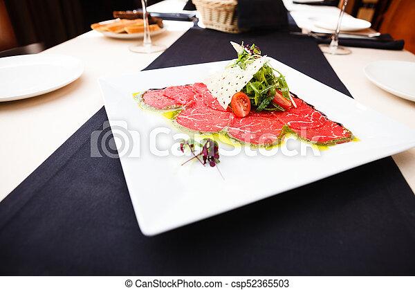 Beef carpaccio with salad - csp52365503