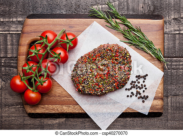 Beef raw steak with pepper and garlic on wood - csp40270070