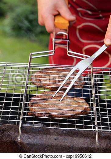 beef steak grilled on a barbecue - csp19950612