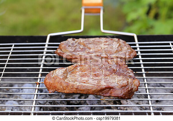 beef steak grilled on a barbecue  - csp19979381