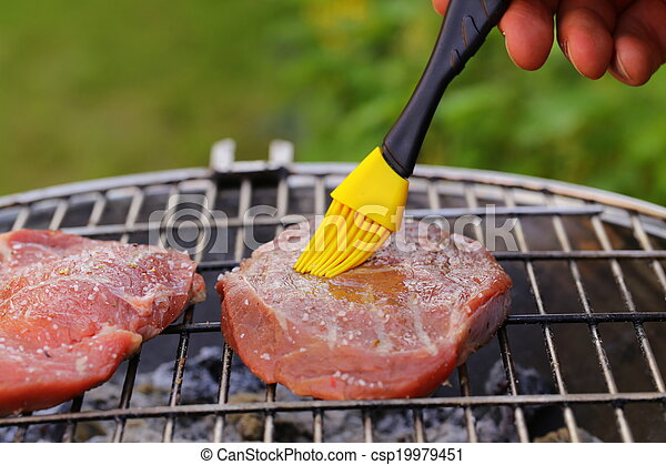 beef steak grilled on a barbecue  - csp19979451