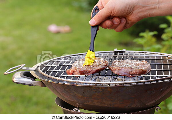beef steak grilled on a barbecue - csp20016226