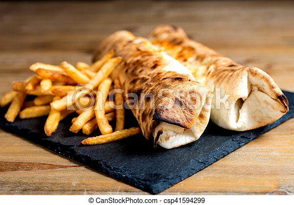beef tacos served with golden French fries - csp41594299