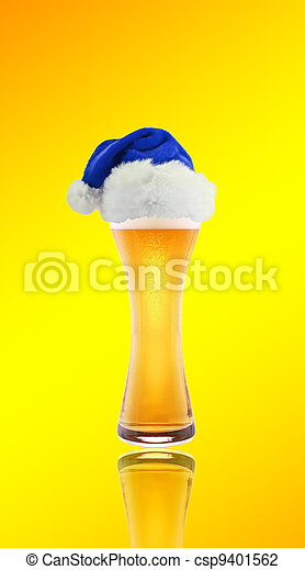 Beer and hat of Santa Claus on a yellow background - csp9401562