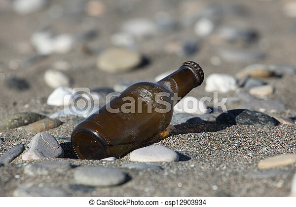 Beer bottle on the beach - csp12903934