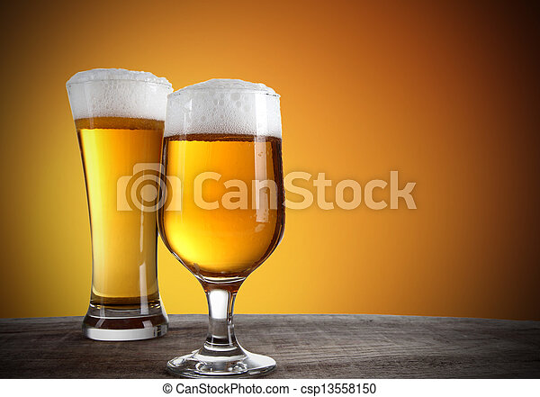 Beer glasses with gold background - csp13558150