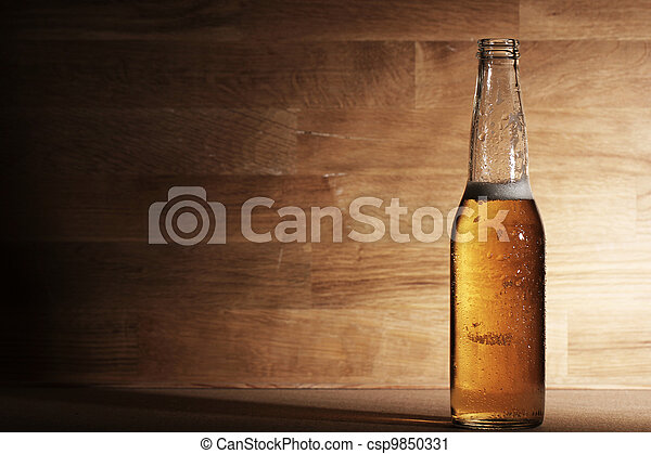 Beer over wooden surface - csp9850331