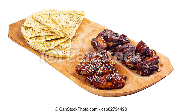 beer snack on the wooden plate - csp62734498