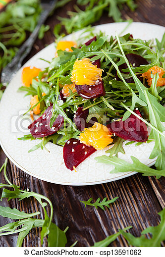 beet salad with fresh arugula and orange - csp13591062
