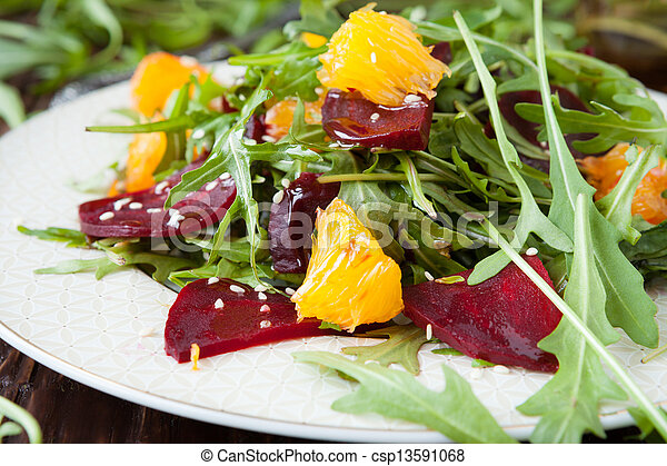 beet salad with fresh arugula and slices of orange - csp13591068
