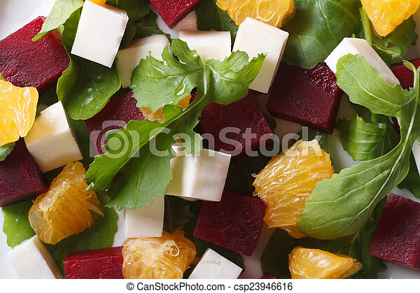 beet salad with oranges, cheese and arugula macro - csp23946616