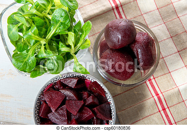 beets in glass bowl with salad - csp60180836