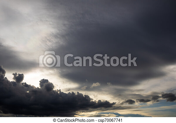 Before heavy rain storm. On the sky is covered all over by the clouds. - csp70067741