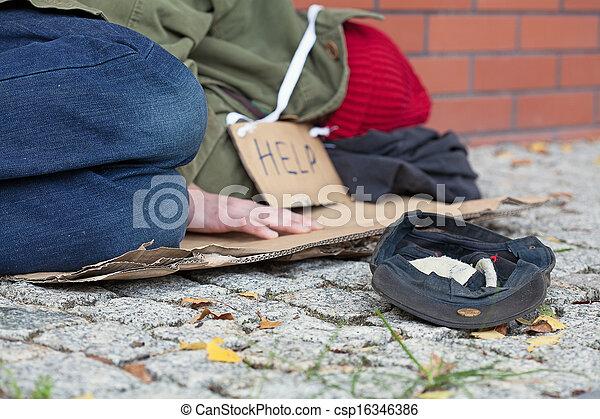 Beggar falling asleep on the street - csp16346386